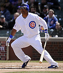 CHICAGO - APRIL  05:  Marlon Byrd #24 of the Chicago Cubs singles against the Arizona Diamondbacks on April 5, 2011 at Wrigley Field in Chicago, Illinois.  The Cubs defeated the Diamondbacks 6-5.  (Photo by Ron Vesely) Subject: Marlon Byrd..