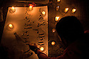 Egyptian protesters light candles during a February 09, 2011 vigil for victims of the 2 week long Egyptian uprising against the Hosni Mubarak regime in Tahrir Square in downtown Cairo, Egypt. Human Rights groups claim close to 300 people have lost their lives so far during the unprecedented and widespread protests across Egypt that threaten to topple the nearly 30 year old regime of Mubarak. (Photo by Scott Nelson).