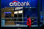 A man walks next to a Citibank branch in New York. 16/10/2012. The Board of Directors of Citigroup announced that Vikram Pandit has stepped down as the Company's CEO and it has unanimously elected Michael Corbat as new CEO and a director of the Board. Photo by Eduardo Munoz Alvarez / VIEWpress.