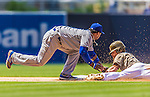 23 June 2013: Los Angeles Dodgers infielder Hanley Ramirez gets Logan Forsythe out at second in an attempted steal during the 6th inning against the San Diego Padres at Petco Park in San Diego, California. The Dodgers defeated the Padres 3-1, splitting their 4-game Divisional Series at 2-2. Mandatory Credit: Ed Wolfstein Photo *** RAW (NEF) Image File Available ***
