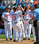 14 March 2009: Baltimore Orioles' infielder Donnie Murphy celebrates at home plate after hitting a walk-off home run in the bottom of the ninth to win a Spring Training game against the Boston Red Sox at Fort Lauderdale Stadium in Fort Lauderdale, Florida. The Orioles defeated the Red Sox 9-8 in the Grapefruit League matchup. Mandatory Photo Credit: Ed Wolfstein Photo