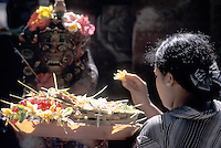A Woman's Offerings and Fearsome God - Bali, Indonesia