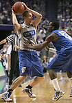 UK guard Jon Hood, left, is guarded by guard John Wall during the first period of the Blue and White scrimmage at Rupp Arena Wednesday night..Photo by Zach Brake | Staff