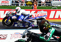 Sept 9, 2012; Clermont, IN, USA: NHRA pro stock motorcycle rider Hector Arana Jr (far lane) races alongside Andrew Hines during the US Nationals at Lucas Oil Raceway. Mandatory Credit: Mark J. Rebilas-