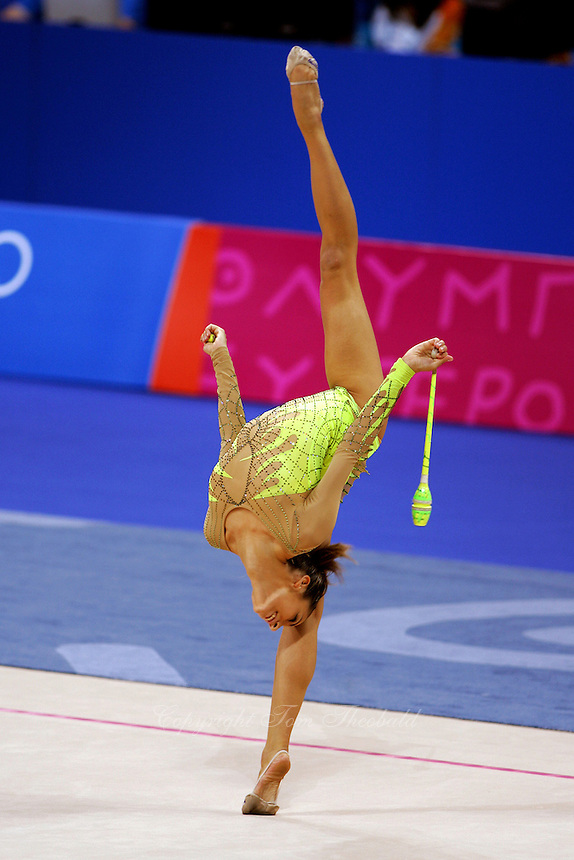Almudena Cid of Spain back flexion with clubs at 2004 Athens Olympic Games during All-Around final on August 29, 2006 at Athens, Greece. (Photo by Tom Theobald)
