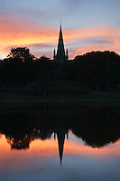 Sunset silhouette reflection of Nidaros cathedral in Nidelva river, Trondheim, Norway
