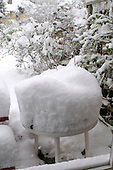 Winter snow piled high on a garden table.