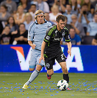 Alex Caskey, Chance Myers. Sporting Kansas City won the Lamar Hunt U.S. Open Cup on penalty kicks after tying the Seattle Sounders in overtime at Livestrong Sporting Park in Kansas City, Kansas.