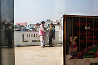 Santwana Manju (in pink), 34, counsels Brinda as she arrives from a neighbouring state in the Guria office in Varanasi, Uttar Pradesh, India on 22 November 2013. She is one of the 57 underaged and trafficked girls rescued from the Shivdaspur red light area in Varanasi, who has been fighting a court case against her traffickers and brothel owners for the past 8 years.