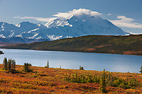 Canoe on Wonder Lake, Mt Denali of the Alaska range mountains, Denali National Park, interior, Alaska.