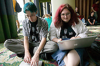 Attendees of the 6th edition of HOPE, an annual hackers' convention, spend time on their laptops, July 23rd 2006, New York City, USA.