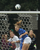 Corner kick action.Boston College defender Zoe Lombard (20), Duke University defender Malinda Allen (22), Duke University goalkeeper Ali Kershner (12).Boston College (white) defeated Duke University (blue/white), 4-1, at Newton Campus Field, on October 6, 2013.
