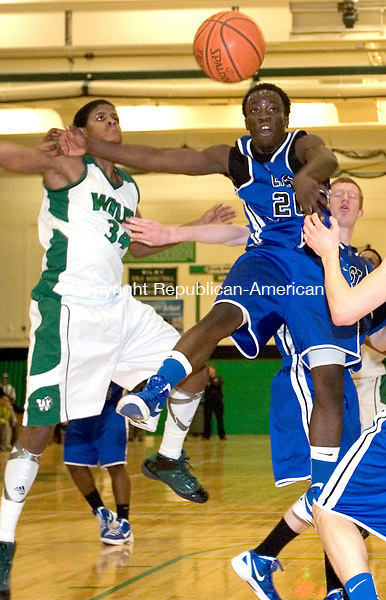 WATERBURY, CT. 07 March 2012-030712SV03-#34 Ezekiel Canady of Wilby and #20 Marques Wiafe of East Catholic battle for the rebound during the second round of the CIAC Class L basketball tournament at Wilby High in Waterbury Wednesday..Steven Valenti Republican-American