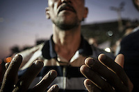 In this Friday, Jul. 12, 2013 photo, a Muslim supporter of the ousted president Mohammed Morsi offers prayers in the streets nearby Al Rabaa mosque in Nasr City, Cairo. (Photo/Narciso Contreras).