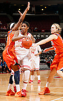 Ohio States Raven Ferguson jumps for two points while guarded by Sarah Hartwell (0) in the second half of their game against the Illinois Fighting Illini at the Value City Arena in Columbus, Ohio on January 30, 2014. (Columbus Dispatch photo by Brooke LaValley)