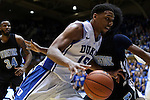 04 November 2014: Duke's Jahlil Okafor (15) drives past Livingstone's Shawn Jackson (right). The Duke University Blue Devils hosted the Livingstone College Blue Bears at Cameron Indoor Stadium in Durham, North Carolina in an NCAA Men's Basketball exhibition game.