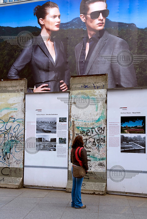 Tourists at the remains of the Berlin Wall at Potsdamer Platz in Berlin.