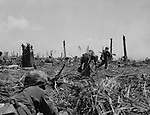 March 16, 1944 - Marines following the front lines mopping up.
