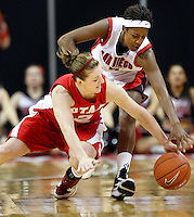 Utah forward Kalee Whipple scrambles for the loose ball with San Diego St. guard Jene Morris as Utah plays against San Diego State in the Mountain West Conference basketball Championship Tournament at the Thomas &amp; Mack Center in Las Vegas, Nevada Saturday, March 13, 2010.  August Miller, Deseret News .