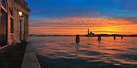 A flaming sunrise over the Giudecca Canal and San Giorgio Maggiore, from Punta della Dogana - better known among Venetians as Punta da Màr. Taken at dawn at the beginning of December, this is a stitch of four vertical takes.