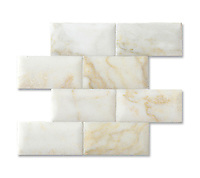3&quot; x 6&quot; Brick shown in pillowed and honed Cloud Nine are part of New Ravenna's Studio Line. All mosaics in this collection are ready to ship within 48 hours.<br />