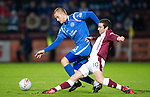 Hearts v St Johnstone....11.01.11  Scottish Cup.Stephen Elliott loses out to Danny Grainger.Picture by Graeme Hart..Copyright Perthshire Picture Agency.Tel: 01738 623350  Mobile: 07990 594431