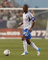 Montreal Impact midfielder Collen Warner (18) dribbles at midfield. In a Major League Soccer (MLS) match, Montreal Impact defeated the New England Revolution, 1-0, at Gillette Stadium on August 12, 2012.