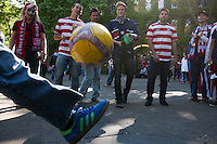 USA fans kick around a soccer ball in Occidental Park before USA Men's National Team's World Cup Qualifier against Panama at Century Link Field in Seattle, WA on June 11, 2013.