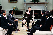 United States President Ronald Reagan makes a point during an interview with television network anchors in the Oval Office of the White House in Washington, D.C. on Thursday, December 3, 1987.  Seated, from left, are: Tom Brokaw of NBC; Bernard Shaw of CNN; President Reagan; Dan Rather of CBS; and Peter Jennings of ABC..Mandatory Credit: Bill Fitz-Patrick - White House via CNP