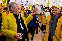 Roma 6 Febbraio 2015<br /> Manifestazione in Campidoglio, per &laquo;difendere il latte italiano&raquo;, organizzato dalla Coldiretti, e l&rsquo;Associazione italiana allevatori che  hanno portato le  mucche  nelle piazze italiane per sensibilizzare opinione pubblica e istituzioni sulla crisi del settore lattiero-caseario. Il ministro del Lavoro Giuliano Poletti con la mucca della Coldiretti.<br /> Rome February 6, 2015<br /> Demostration  at the Capitol, to &quot;defend the Italian milk&quot;, organized by Coldiretti, and the Association of Italian farmers who brought the cows in the Italian squares to sensitize public opinion and institutions on the crisis of the dairy sector. The  Minister Labour  Giuliano Poletti, with the cow of the Coldiretti.