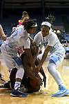 01 February 2015: Boston College's Ashley Kelsick (center) fights for a loose ball with North Carolina's Danielle Butts (10) and Allisha Gray (right). The University of North Carolina Tar Heels hosted the Boston College Eagles at Carmichael Arena in Chapel Hill, North Carolina in a 2014-15 NCAA Division I Women's Basketball game. UNC won the game 72-60.