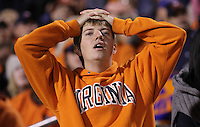 Nov 13, 2010; Charlottesville, VA, USA; Virginia Cavaliers fan Mike Collinsworth places his hands to his head during the 42-23 loss to the Maryland Terrapins at Scott Stadium. Mandatory Credit: Andrew Shurtleff