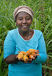 Romicile Jean Luis shows corn she has harvested in Mizak, a small village in the southern mountains of Haiti. The United Methodist Committee on Relief (UMCOR) is working with her and other farmers in the community to improve their agricultural production.