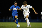 06 December 2014: UCLA's Felix Vobejda (GER) (7) and North Carolina's Alan Winn (5). The University of California Los Angeles Bruins hosted the University of North Carolina Tar Heels at Drake Stadium in Los Angeles, California in a 2014 NCAA Division I Men's Soccer Tournament Quarterfinal round match. The game ended in a 3-3 tie after two overtimes. UCLA advanced to the next round by winning the penalty kick shootout 7-6.