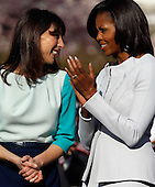 First Lady Michelle Obama (R) and Samantha Cameron talk during the official arrival ceremony at the South Lawn of the White House March 14, 2012 in Washington, DC. Prime Minister Cameron is on a three-day visit to the U.S. and he is expected to have talks with Obama on the situations in Afghanistan, Syria and Iran..Credit: Chip Somodevilla / Pool via CNP