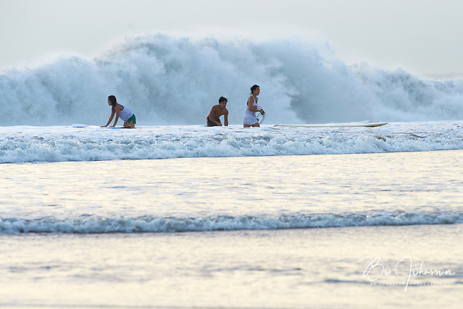 Evening surfing in the famous waves of Kuta Beach.<br /> Kuta, Bali, Indonesia.<br /> July 2011.<br /> Only for editorial use.