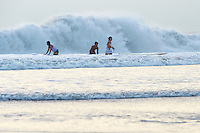 Evening surfing in the famous waves of Kuta Beach.<br />