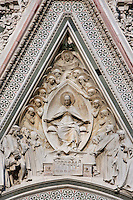 Cathedral Santa Maria del Fiore, Florence, Italy , also known as the Duomo, begun in 1296 by Arnolfo di CAMBIO, dome by Filippo BRUNELLESCHI, 1377-1446, completed in 1436. Detail of relief sculpture in the style of the Pisan School in the tympana above the main portal pictured on June 8 2007.