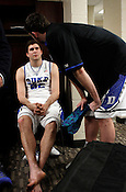 Ryan Kelly tries to cheer up Todd Zafirovski afterwards in the locker room. Lehigh defeated Duke 75-70 during the 2nd round of the 2012 NCAA Basketball Championship at the Greensboro Coliseum in Greensboro, NC. Photo by Al Drago.