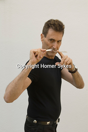 Uri Geller at home Berkshire England 2008. Bending spoon 1st image taken at 16. 35.44 pm.