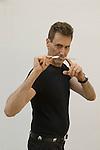 Uri Geller at home Berkshire England 2008. Bending spoon 1st image taken at 16. 35.44 pm.