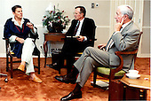 United States President Ronald Reagan, left, meets with Vice President George H.W. Bush, center, and White House Chief of Staff Donald Regan at Bethesda Naval Medical Center on Wednesday, July 17, 1985..Mandatory Credit: Pete Souza - White House via CNP