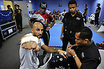 Egyptian boxing champion Hisham Hiba getting hamds dressed before fight in Blue corner locker room<br />