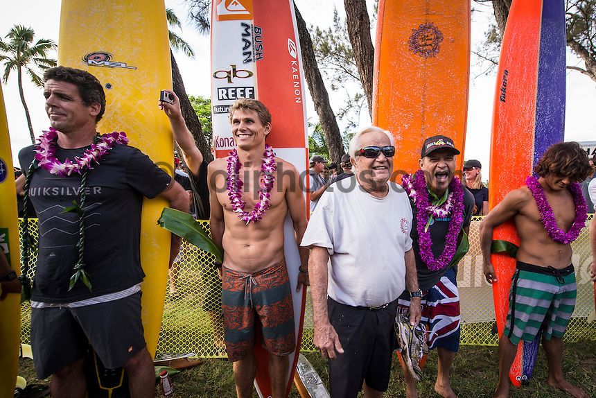 Waimea Bay, North Shore of Oahu, Hawaii.  December 4 2014) Ramon Navarro (CHL), Peter Mel (USA), Jamie Mitchell (AUS) Dick Brewer (HAW) and Clyde Aikau (HAW).. - The Opening Ceremony of the 2014 Quiksilver In Memory of Eddie Aikau contest was held this afternoon in the park at Waimea Bay. This winter, the big wave riding event celebrates a special milestone of 30 years. <br /> The Quiksilver In Memory of Eddie Aikau is a one-day big wave riding event that only takes place if and when waves meet a 20-foot minimum height, during the holding period of December 1 through February 28, each Hawaiian winter. The official Opening Ceremony with the Aikau Family will be held on Thursday, December 4th, 3pm, at Waimea Bay.<br />  <br /> &quot;The Eddie&quot; is the original big wave riding event and stands as the measure for every big wave event that exists in the world today. It has become an icon of surfing through its honor, integrity and rarity.<br />  <br /> The event honors Hawaiian hero Eddie Aikau, whose legacy is the respect he held for the ocean; his concern for the safety of all who entered it on his watch; and the way with which he rode Waimea Bay on its most giant and memorable days. <br />  <br /> Adherence to strict wave height standards has ensured its integrity; it is only held on days when waves meet or exceed the Hawaiian 20-foot minimum (wave face heights of approximately 40 feet). This was the threshold at which Eddie enjoyed to ride the Bay. It has been said that what makes The Eddie special is the times it doesn't run, because that is precisely its guarantee of integrity and quality days of giant surf.<br />  <br /> The competition has only been held a total of 8 times: it's inaugural year at Sunset Beach, and then seven more times at its permanent home of Waimea Bay. The Eddie was last held on December 9, 2009, won by California's Greg Long.   Photo: joliphotos.com