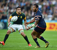 Andrew Suniula of the USA passes the ball. Rugby World Cup Pool B match between South Africa and the USA on October 7, 2015 at The Stadium, Queen Elizabeth Olympic Park in London, England. Photo by: Patrick Khachfe / Onside Images