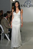 "Model walks runway in an Abby Bridal gown - ivory beaded Chantilly lace short halter dress, from the Anne Bowen Bridal Spring 2013 ""Coat of Arms"" collection fashion show, during Bridal Fashion Week New York April 2012."
