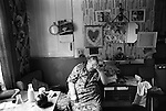 Older woman in her living room Peabody Estate flat tenement building Tower Hamlets east London UK 1975 <br /> <br /> 16x12 PARIS 2015 LES DOUCHES LA GALERIE <br /> <br /> <br /> THIS ARE MEDIUM RES FILES ONLY FOR VIEWING AND SHOULD NOT BE SENT OUT