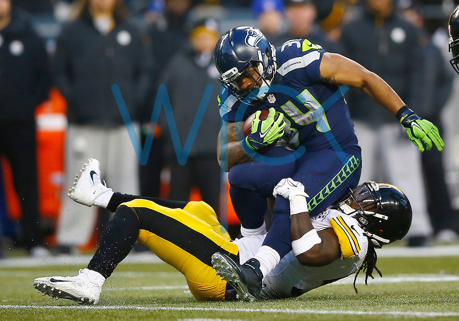 Thomas Rawls #34 of the Seattle Seahawks is tackled by Sean Spence #51 of the Pittsburgh Steelers in the second half during the game at CenturyLink Field on November 29, 2015 in Seattle, Washington. (Photo by Jared Wickerham/DKPittsburghSports)
