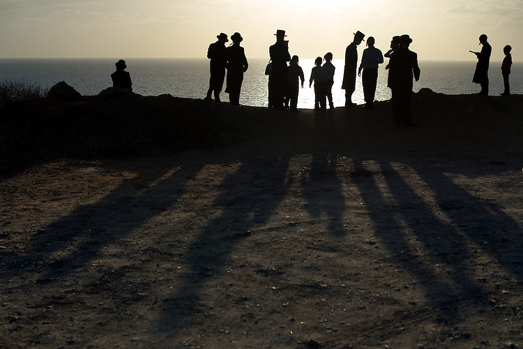 Ultra-Orthodox Jewish men and children gather for a 'Tashlich' ritual along the Mediterranean Sea in Herzliya, central Israel. 'Tashlich' ('to cast away') is a Jewish practice by which believers go to a flowing body of water and symbolically 'throw away' their sins, before the Day of Atonement ('Yom Kippur'), the holiest day in the Jewish calendar.