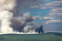 Columns of smoke rise from the boreal forest of spruce and hardood trees in interior Alaska, as the Hastings forest fire north of Fairbanks increases its reach beyond 12,000 acres on June 7, 2011.